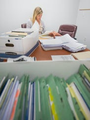 Attorney Marci McCoy goes through the records of a