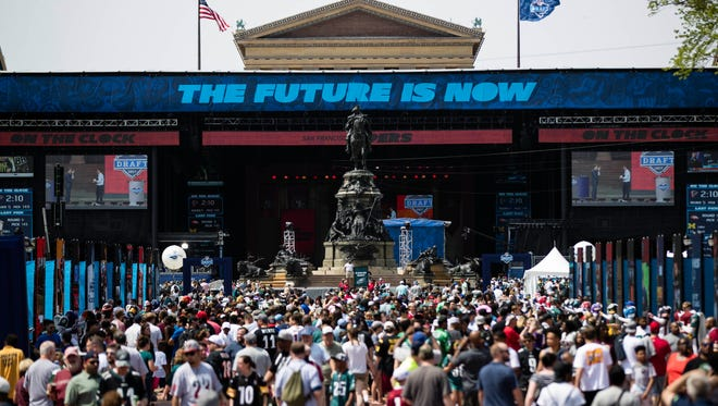 Fans gather for the 2017 NFL football draft, Saturday, April 29, 2017, on the steps of the Philadelphia Museum of Art in Philadelphia.