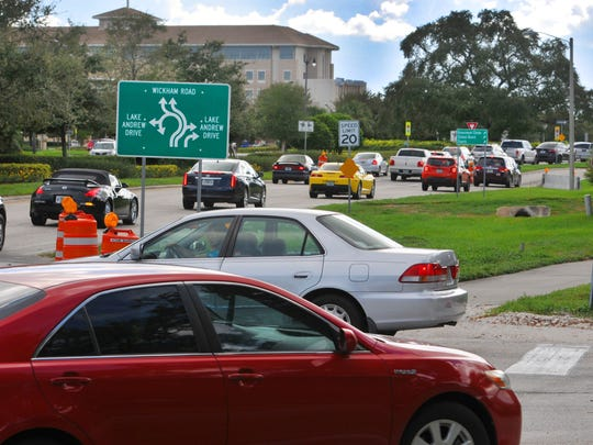 Motorists make their way toward the Viera roundabout on Wickham Road during rush hour.