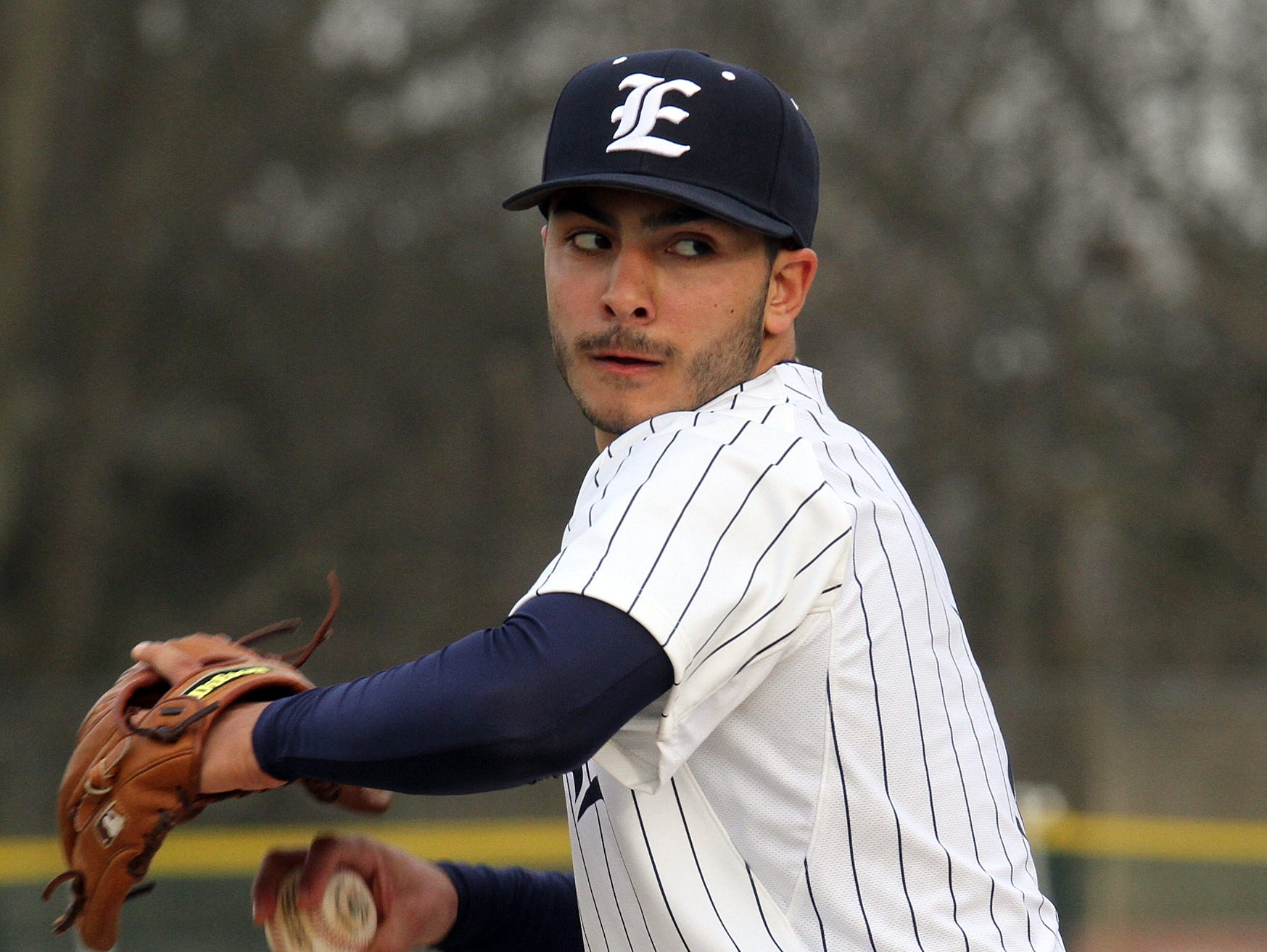 Eastchester's Greg Satriale pitches against Pleasantville during Thursday's game at Eastchester High School. Eastchester defeated Pleasantville 2-1 in 10 innings.