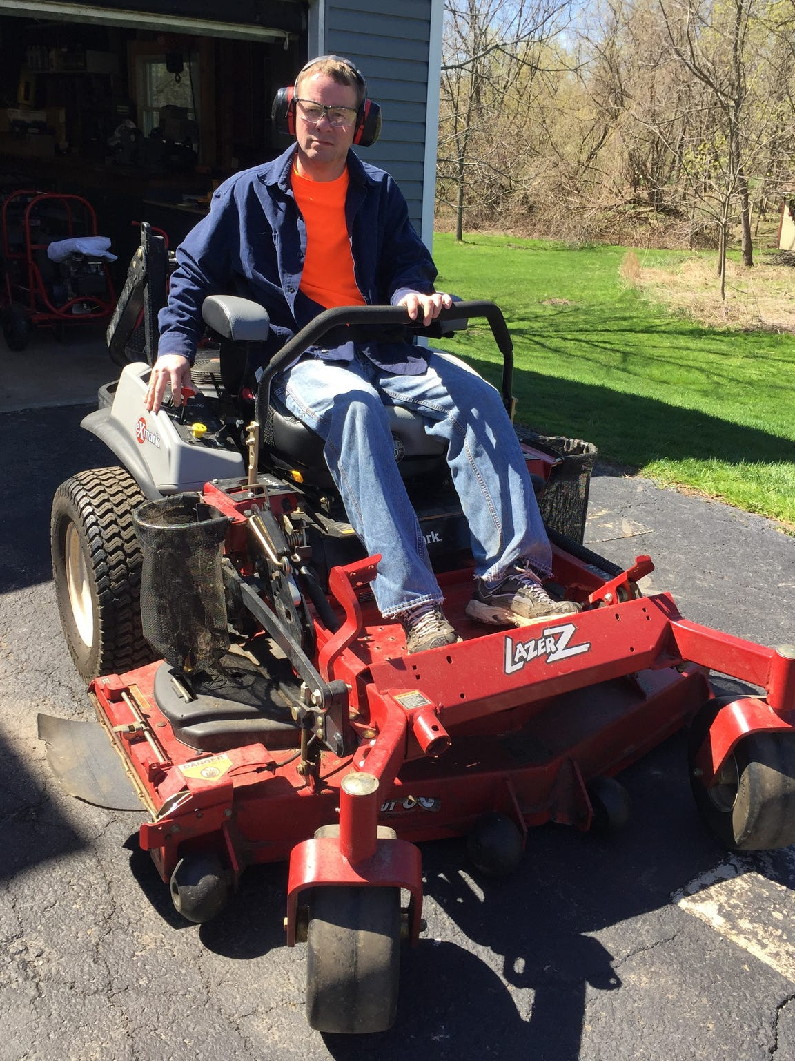 Kevin Flannery heading out to mow his grass for the