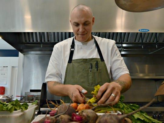 Matt Kern prepares veggies for the dinner rush at Heirloom.