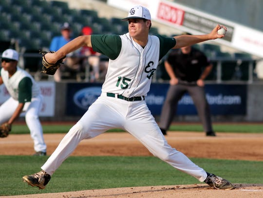 East Brunswick's Tyler Burnham pitches in last year's