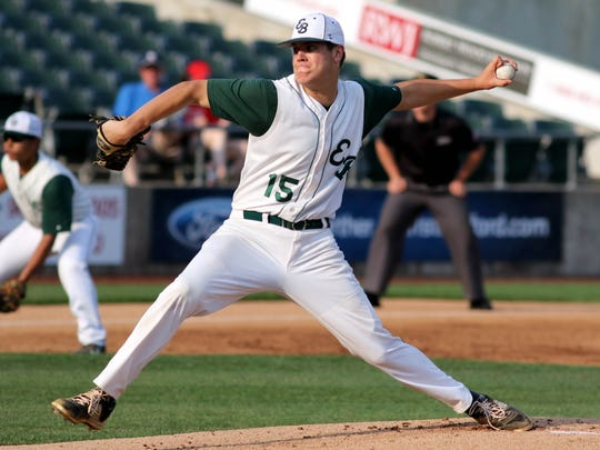 East Brunswick's Tyler Burnham pitches in last year's GMCT final.