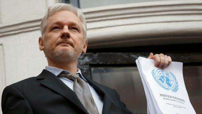 Julian Assange, shown in London in February 2016 with a U.N. working group finding on his case, was turned down by Sweden's appeals court in his bid to get an arrest warrant against him lifted in a rape case.