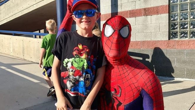 'Spidey' poses with a happy fan at 'Be a Hero' night at the St. Lucie Mets.