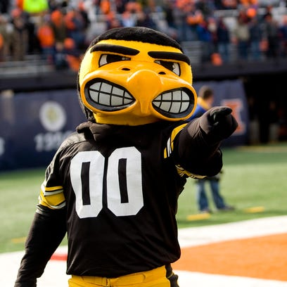 "Iowa Hawkeyes mascot ""Herky"" poses for a photo in the"