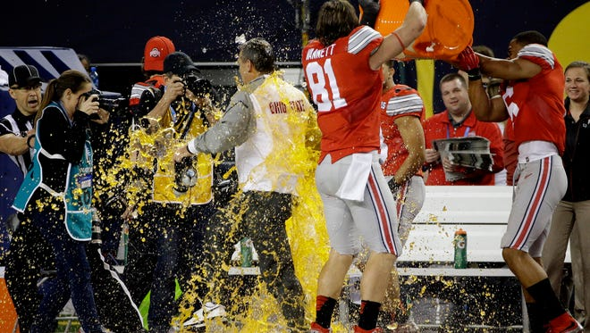 Ohio State head coach Urban Meyer is dunked during the second half of the NCAA college football playoff championship game against Oregon Monday, Jan. 12, 2015, in Arlington, Texas. Ohio St. won 42-20. (AP Photo/David J. Phillip)