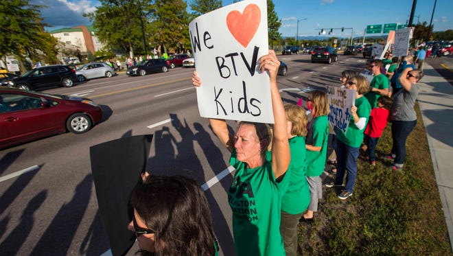 Teachers and their supporters honk and wave along Williston Road at a gathering sponsored by the Burlington Education Association on Tuesday, September 27, 2016.  The teachers union is opposed to a contract recently imposed by the school board.