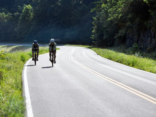 Jenny Young and Belinda Leslie bike the Natchez Trace Parkway in Franklin on July 10, 2017.