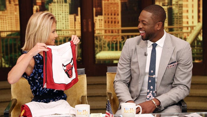 "Host Kelly Ripa, left, and NBA player Dwyane Wade chat during a production of ""Live Kelly"" in New York on Thursday, July 7, 2016."