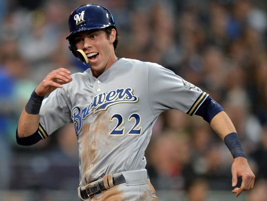 Brewers centerfielder Christian Yelich reacts after