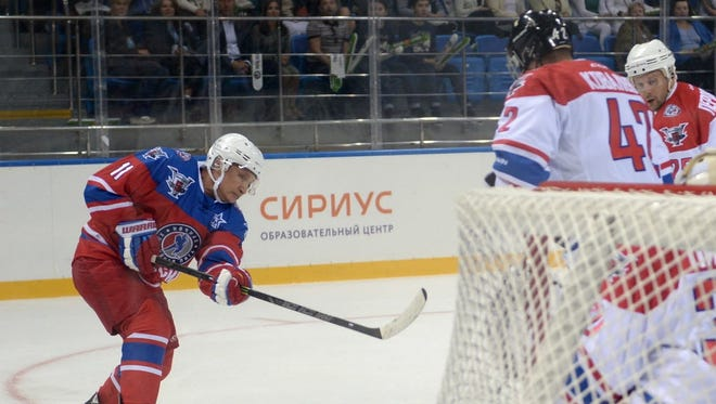 Russian President Vladimir Putin takes part in a hockey match during the opening of a new season of the Night Ice Hockey League in Sochi, Russia, on Oct. 7, 2015.
