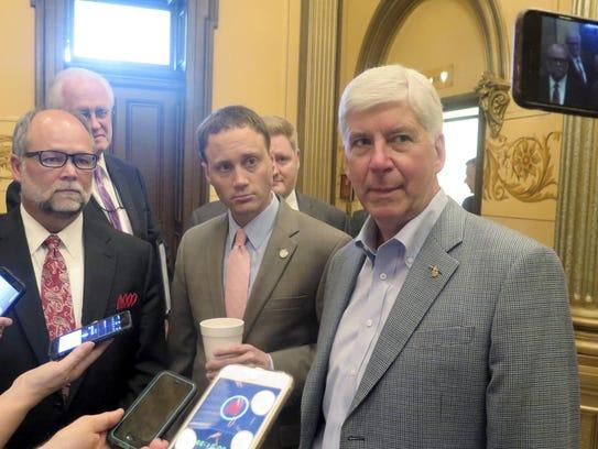 Michigan Gov. Rick Snyder, right, House Speaker Tom
