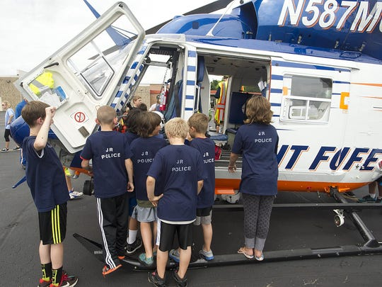 Members of the Junior Police Academy in Oakfield look into the Flight for Life helicopter. The helicopter made a stop at the Oakfield High School as part of the three-week Junior Police Academy class.