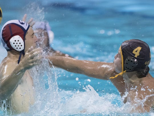 Redwood goalie Koby Ramage, left, deflects Golden West's
