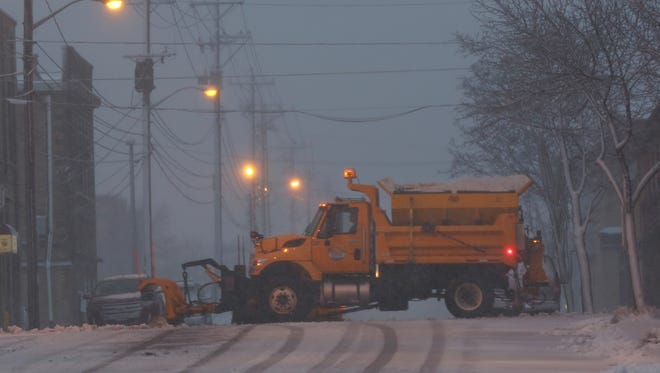 Manitowoc Public Works plow trucks have begun plowing streets to get a head start of the snow plow on Wednesday evening, March 23.
