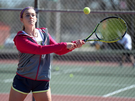 Richmond High School tennis player Kayla Owens practices Tuesday, March 29, 2016 at RHS.