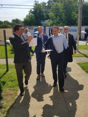 Gov. Matt Bevin enters Western Middle School to discuss gun violence in Louisville with community leaders