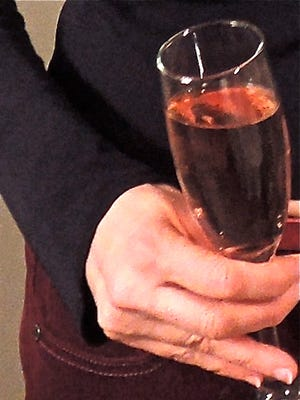 Kir Petillant, or sparkling wine with a splash of creme de cassis (black currant liqueur).