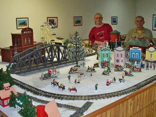 The Clipper City Model Railroad Club, located on the Manitowoc County Expo Grounds, will hold its Spring Train Show from 3 to 6 p.m. May 5 and noon to 4 p.m. May 6-7. Pictured with one of the train layouts are Dave Johanek (left) and Alan Ross.