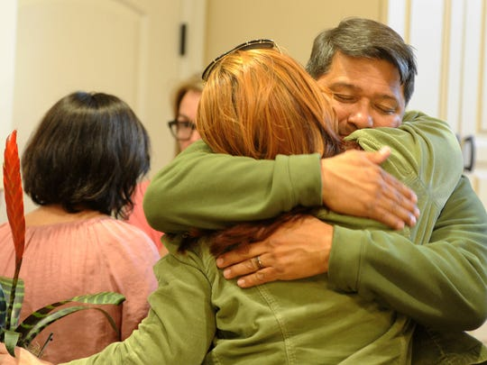 Manny Vega hugs Joy Abrams at his home in Oxnard. His son, Patrick Vega, died Sunday, less than two weeks after he arrived for Marine boot camp.