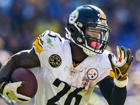 FILE - In this Oct. 1, 2017, file photo, Pittsburgh Steelers running back Le'Veon Bell (26) carries the ball during the second half of an NFL football game against the Baltimore Ravens in Baltimore. A person with direct knowledge of the negotiations says the New York Jets and Bell have agreed to a deal early Wednesday morning, Mach 13, 2019, a person with direct knowledge of the negotiations told The Associated Press. The deal gives new coach Adam Gase and second-year quarterback Sam Darnold a big-time playmaker, arguably the best player at his position before Bell opted to sit out all of last season rather than sign a franchise tender with Pittsburgh.  (AP Photo/Gail Burton, File)