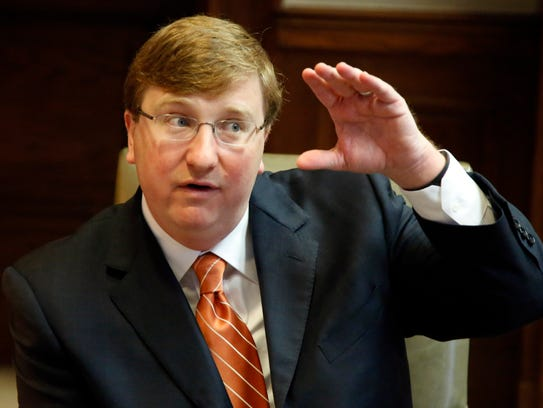 Republican Lt. Gov. Tate Reeves gestures during a discussion