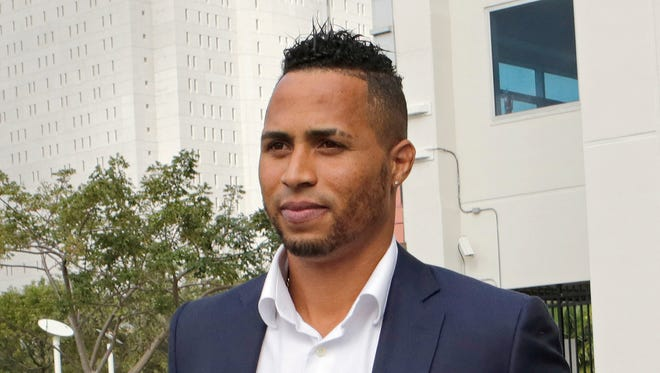 Mariners outfielder Leonys Martin walks out of the federal courthouse in Miami. Martin told a jury Tuesday he crossed the U.S.-Mexico border without any valid papers because he feared being kidnapped or worse after he was smuggled from Cuba by a group linked to a sports agent and a baseball trainer.