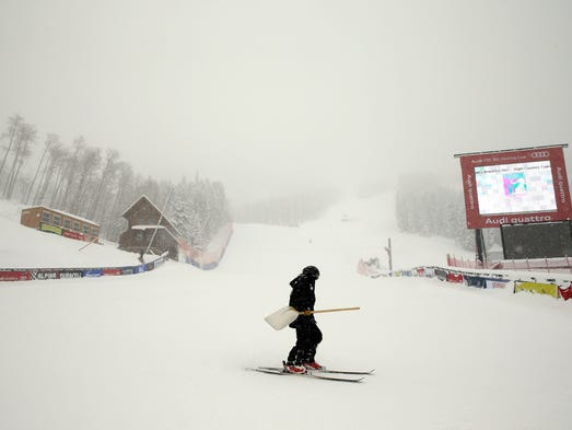 BEAVER CREEK, CO - DECEMBER 04:   A course worker skis past the finish line of the Birds of Prey FIS Ski World Cup course on December 4, 2013 in Beaver Creek, Colorado.  Downhill training was cancelled for excessive snow. (Photo by Ezra Shaw/Getty Images)