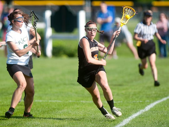 Middlebury's Julia Rosenberg, right, races up the field