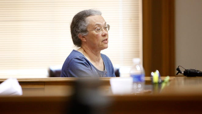 Brown County Coroner Judith Varnau takes the witness stand during a May hearing to determine if she should be removed. She now is the object in a lawsuit by five Brown County sheriff's employees.