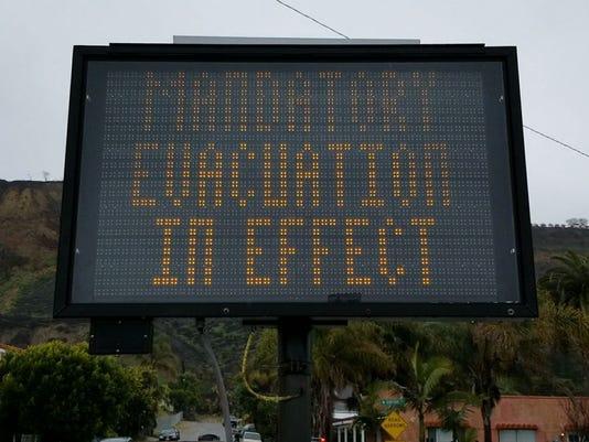 636572475368197311-Rain---Mandatory-evacuation.jpg