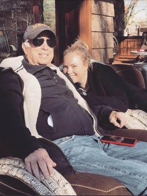U.S. Sen. John McCain and his daughter Meghan relax outside the family's cabin near Sedona in February.