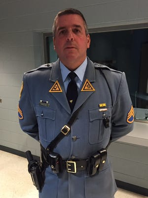 New Jersey State Police Sgt. Sean Boag meets with reporters Saturday night in the lobby of the Troop D Holmdel Station near the PNC Bank Arts Center.