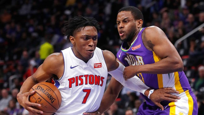 Pistons forward Stanley Johnson drives on Pelicans forward Darius Miller in the first half in Detroit on Feb. 12.