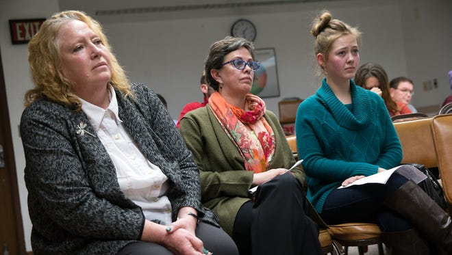Virtual Academy Head School Director Carla Morlas, left, staff member Rebecca Heilman and student Jordan Patterson listen during a Dec. 16 Farmington school board meeting about the future of the school.