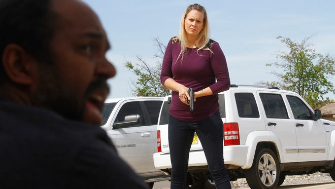 Darryl Deloach, left, a Public Safety Psychology Group role player, talks with Farmington policeOfficer Amy DeMar during a crisis intervention training scenario on June 3, 2016, at the Fraternal Order of the Police in Farmington. Deloach was playing the role of an armed suspect exhibiting mental health problems.