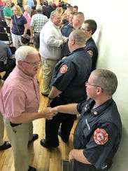 Residents shake the hands of Liberty City Fire Department