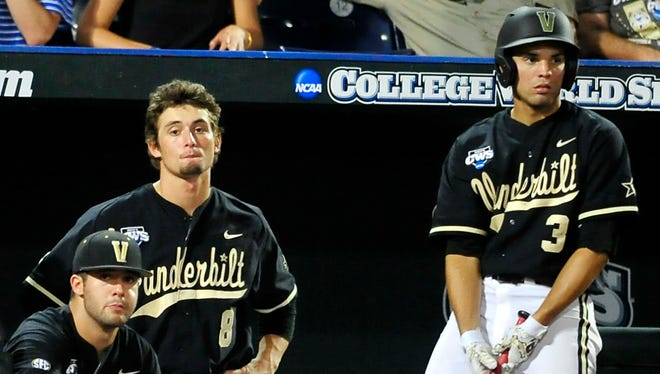 Vanderbilt players, from left, Chris Harvey, Rhett Wiseman and Vince Conde watch the game in the seventh inning Tuesday.