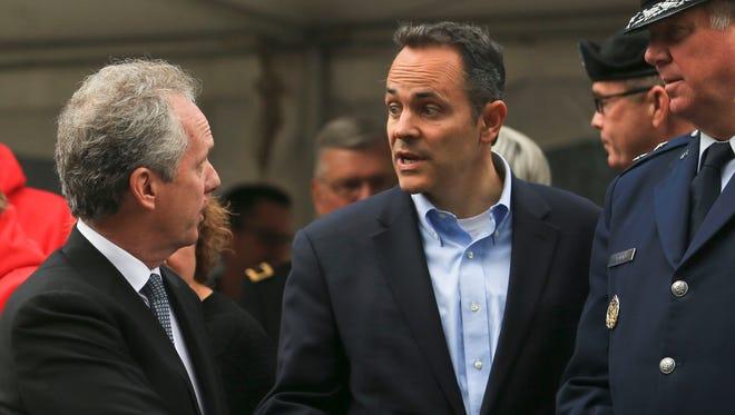 Louisville mayor Greg Fischer talks with Kentucky Gov.-elect Matt Bevin after the Veterans Parade in Louisville.