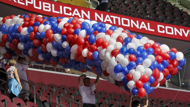 J. Scott Applewhite/APWorkers carry balloons as preparations continue for the Republican National Convention on Friday at Quicken Loans Arena in Cleveland. Workers carry balloons as preparations continue for the Republican National Convention Friday at Quicken Loans Arena in Cleveland.