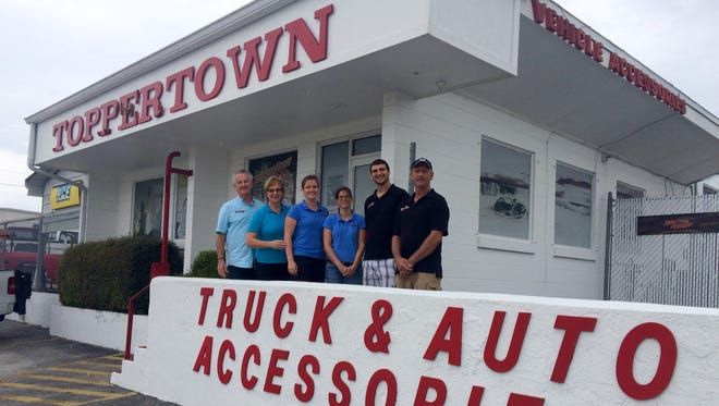Staff photo at Toppertown Incorporated in Cocoa, which sells truck and auto accessories.