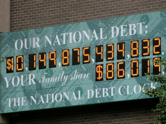 A clock near Times Square in New York City shows the national debt. This picture shows what it looked like in 2008. The national debt has nearly doubled since then – but don't confuse the debt with the federal deficit, which has fallen.