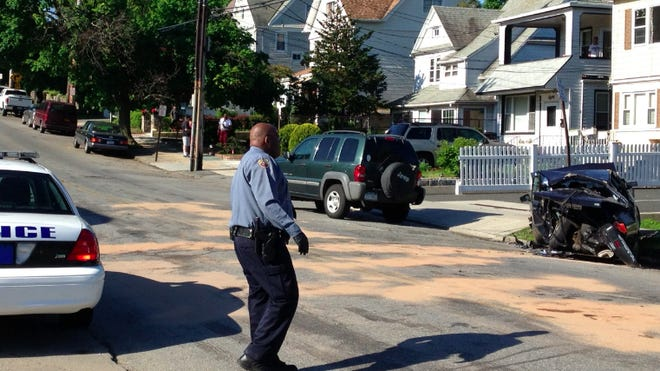 The driver of a silver Cadillac struck fled on foot after striking a parked Nissan Sentra in New Rochelle on Sunday.