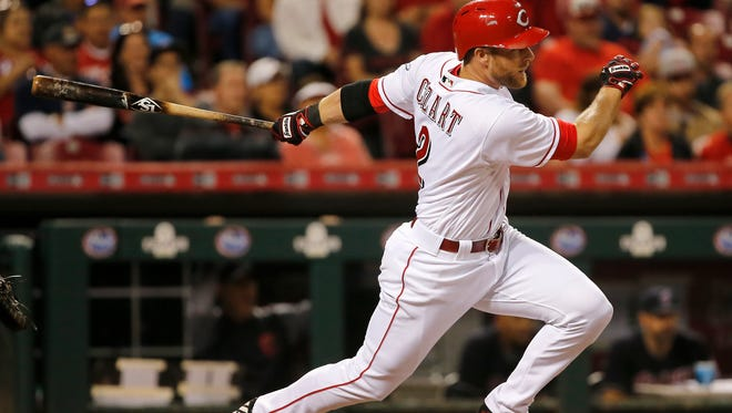 Cincinnati Reds shortstop Zack Cozart (2) doubles in the seventh inning during the interleague baseball game between the Cleveland Indians and the Cincinnati Reds, Monday, May 22, 2017, at Great American Ball Park in Cincinnati.