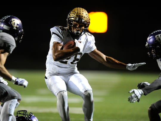 Abilene High running back Abram Smith (28) runs through Keller Timber Creek in 2016. Smith finished his AHS career as the Eagles' all-time rusher.