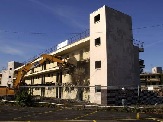 Demolition begins at the former Downtown Motor Lodge