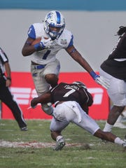 MTSU's Shane Tucker (1) is stopped by Western Michigan's