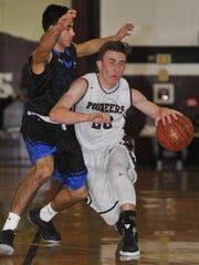 Mt. Whitney's Holden Powell drives to the basket against